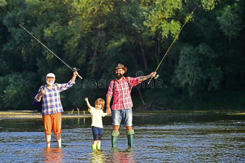 Young - adult concept. Happy fathers day. Fishing became a popular recreational activity. Fly fisherman using fly stock photos
