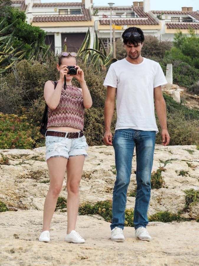 Young adult couple of happy tourists shoot of a beautiful landscape in Catalonia, Spain royalty free stock photos