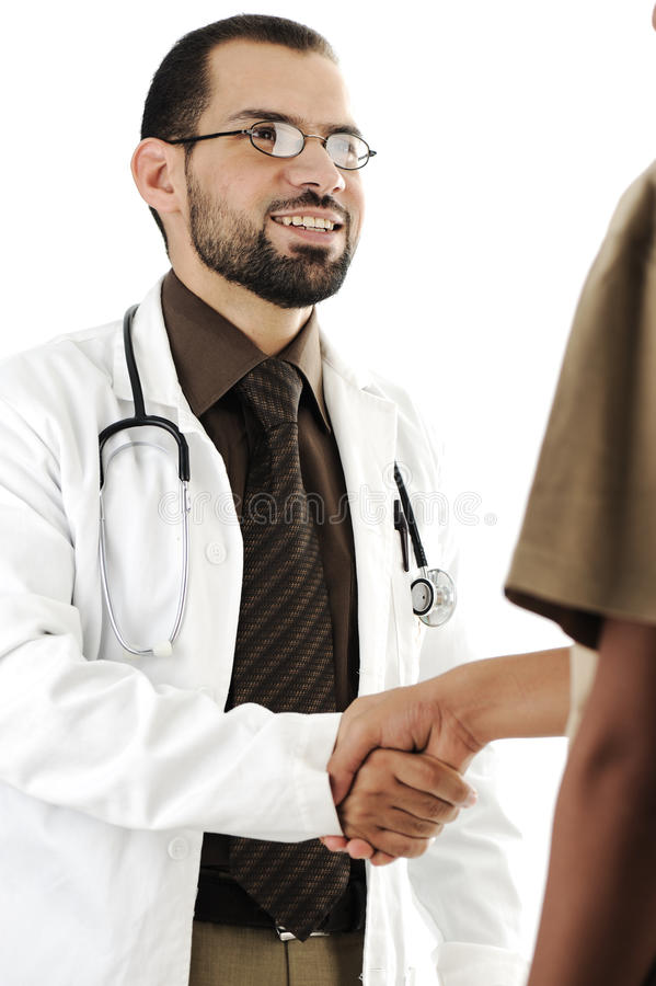 Young adult doctor shaking hand royalty free stock images