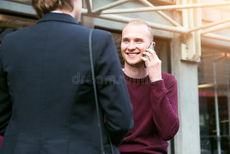 Young adult entrepreneurs people have business meeting talking on the street and making phone call stock image