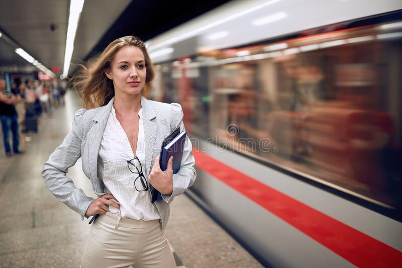 Young adult female just missed the subway train stock photo