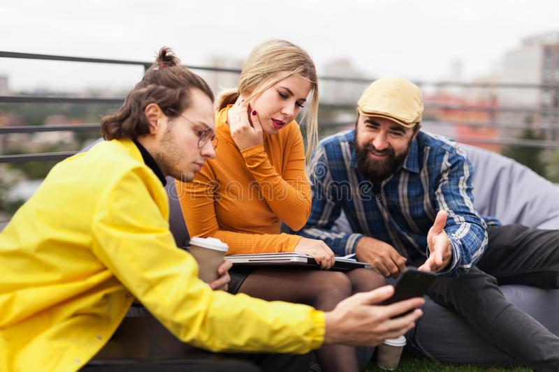 Young and adult friends, hipster group. Happy casual people. Communication concept stock photography