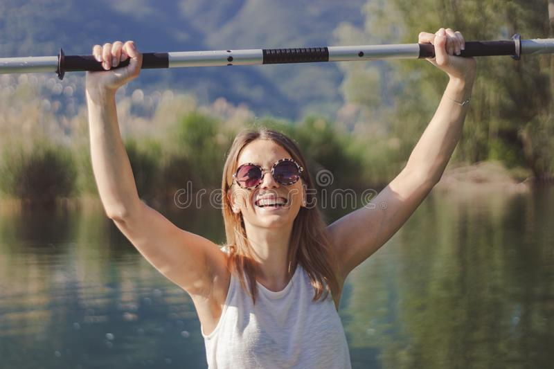 Young woman kayaking on the lake stock photo