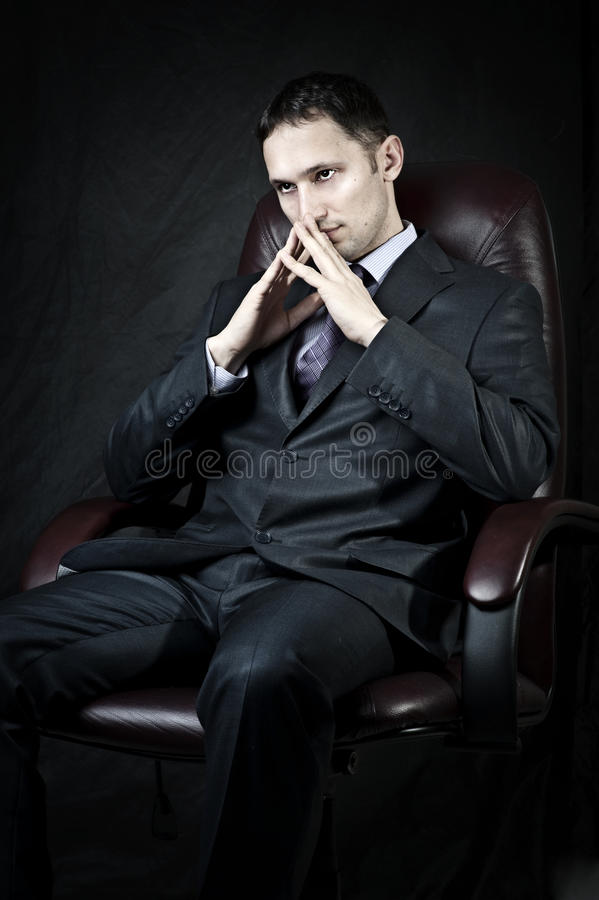 Young adult handsome businessman royalty free stock photography