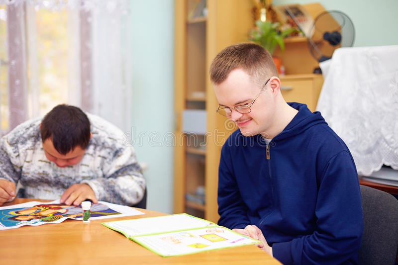 Young adult man engages in self study, in rehabilitation center stock image