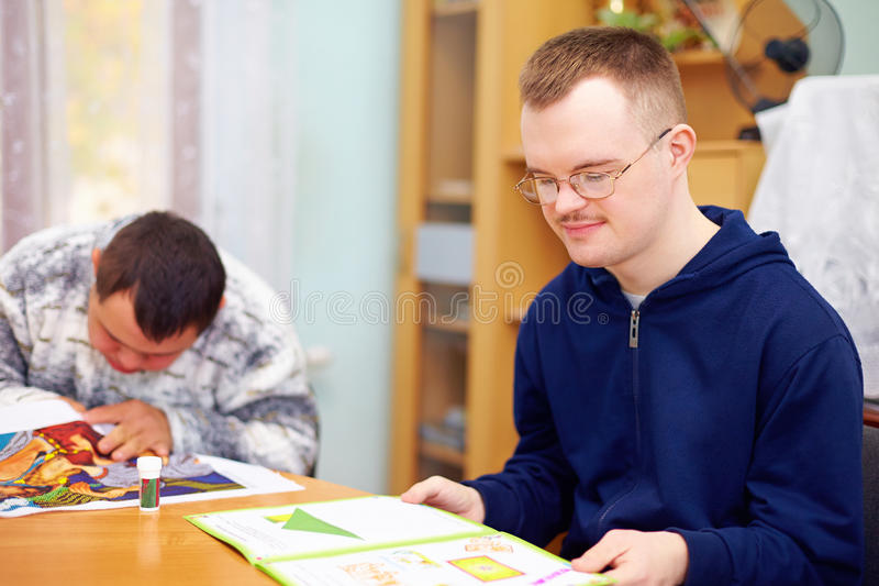 Young adult man engages in self study, in rehabilitation center stock images