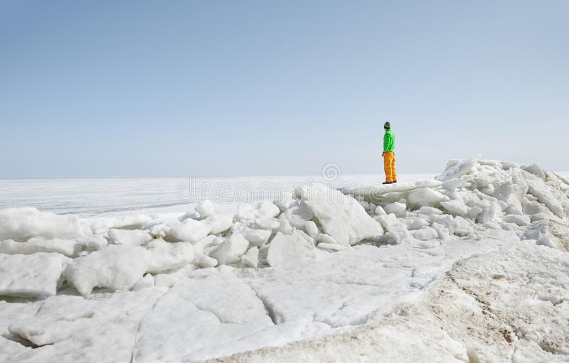 Young adult man outdoors exploring icy landscape stock images