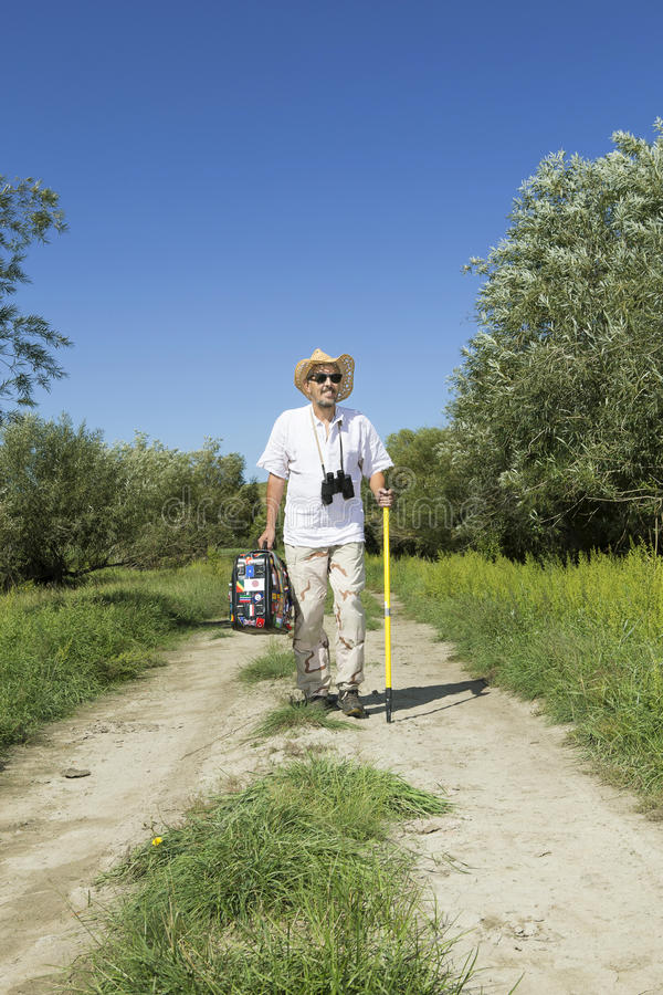Young adult man tourist on rural road stock image