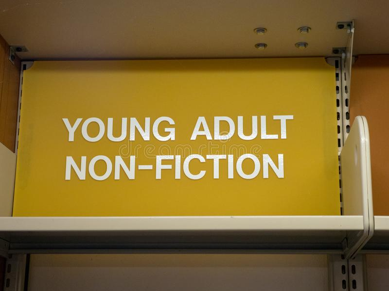 Young adult, non-fiction sign top of library shelf. In Marin, California royalty free stock photo