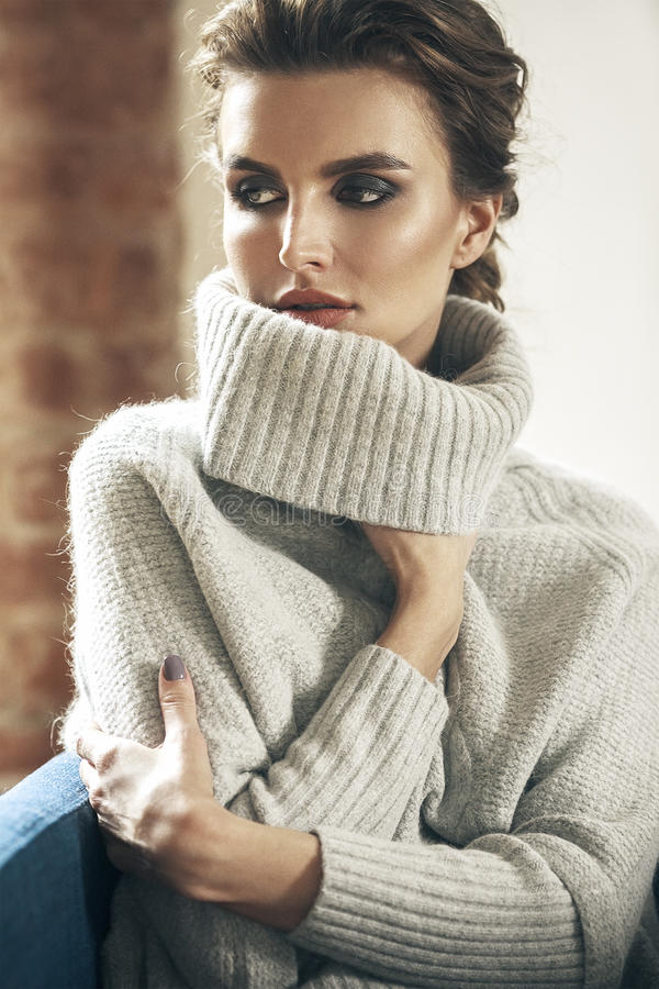 Young adult sensuality brunette woman in gray sweater stock images