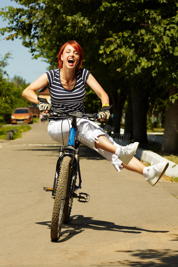 Free Young Adult Smiling Biker Woman On Mounting Bike Royalty Free Stock Photos - 16501498