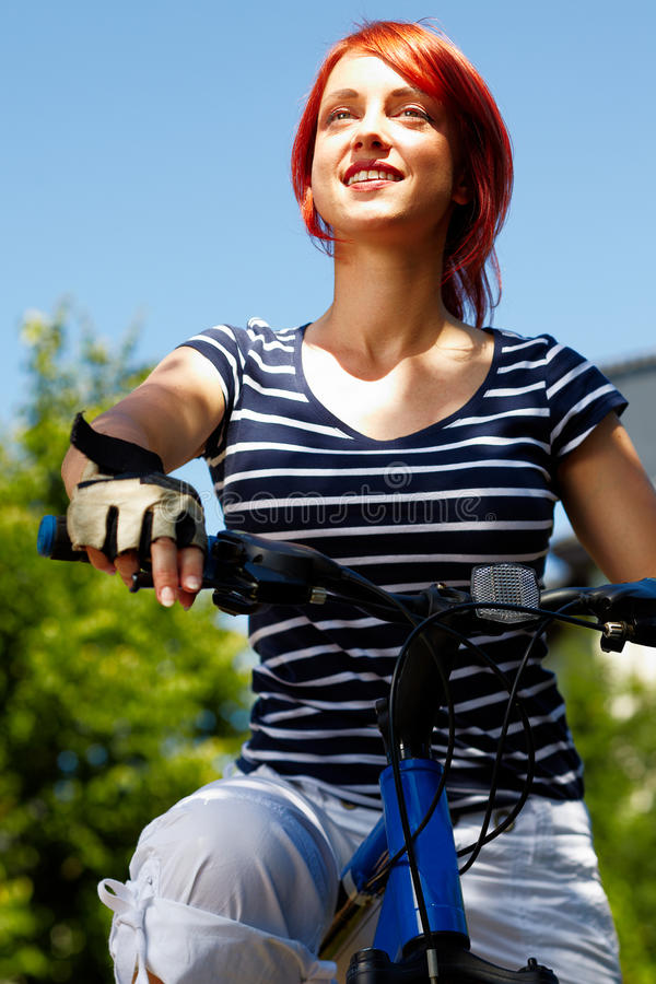 Free Young Adult Smiling Biker Woman On Mounting Bike Royalty Free Stock Photography - 16501527