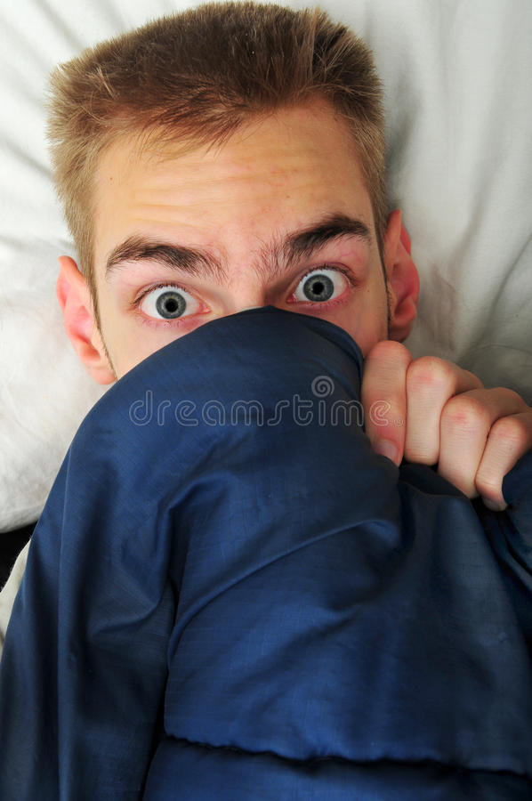 Download Young Adult Teen Hides Under Covers Stock Image - Image: 12563443
