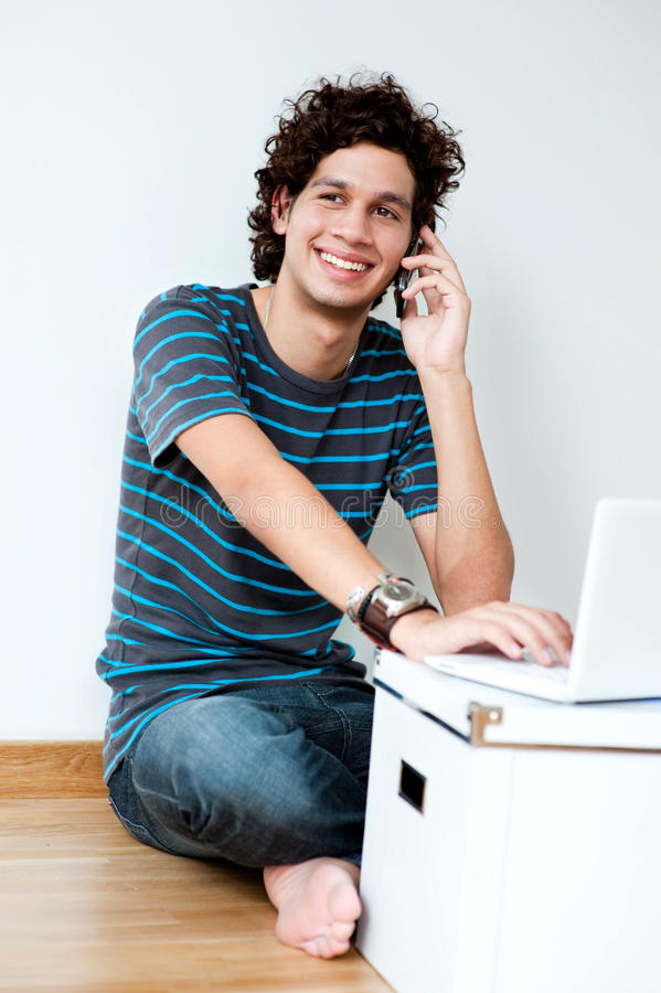 Young Adult Using Laptop royalty free stock image