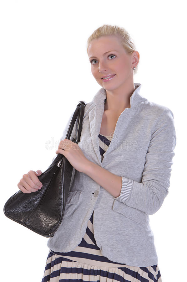 Young adult woman with road bag royalty free stock image