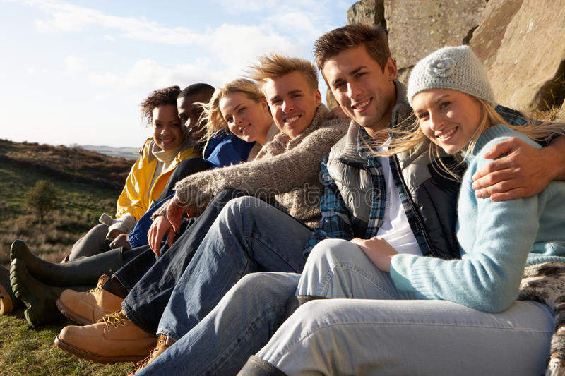 Young adults in countryside. Smiling at camera royalty free stock photo