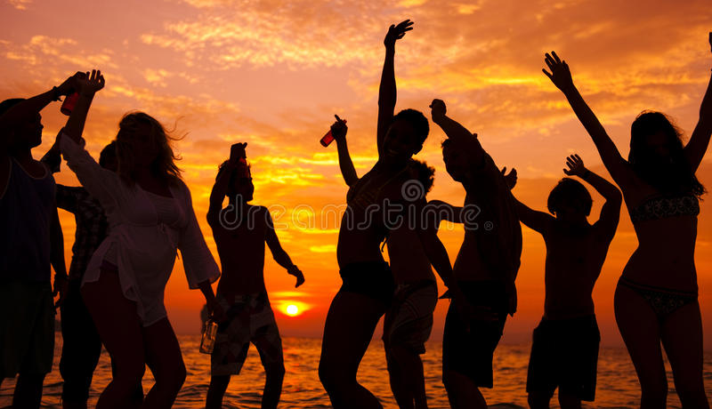 Young adults enjoying a tropical beach party.  stock photo