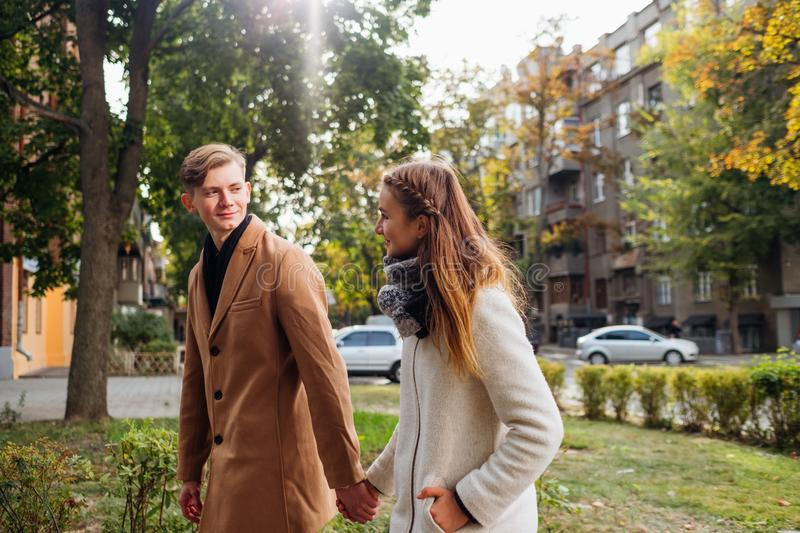 Young adults romantic date happy together. Young adults in romantic relationship. Couple holding hands on a date. Happy together. Free space concept royalty free stock image
