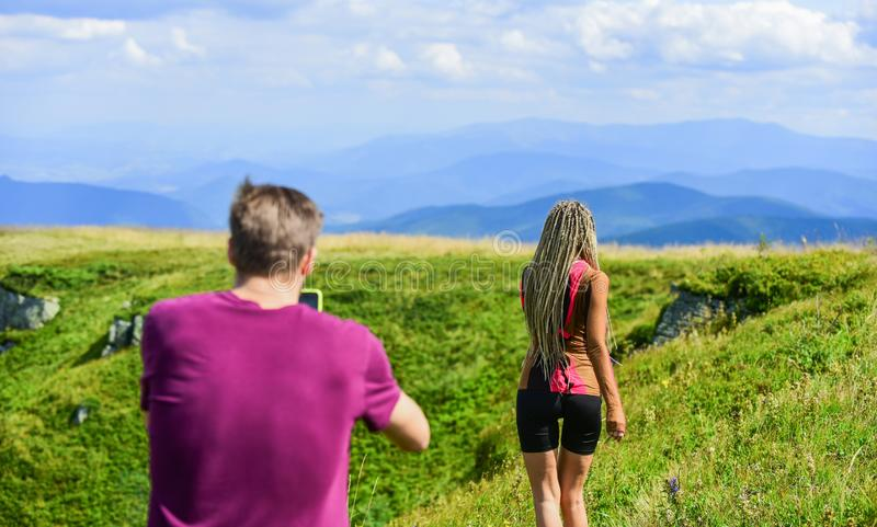 Young adventurers. Travel together with darling. Couple taking photo. Couple in love hiking mountains. Lets take photo. Capturing beauty. Man and women posing royalty free stock images
