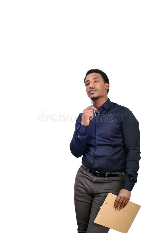 Young African American business man standing against white isolated background and thinking gesture stock photography