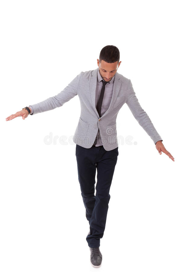 Young african american business man walking on a line - Black pe royalty free stock image