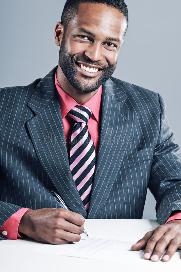 Download Young African American Businessman Being Sneaky On Laptop Stock Photo - Image: 30581032