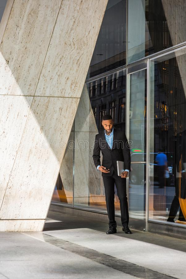 Young African American Businessman thinking outside in New York royalty free stock image