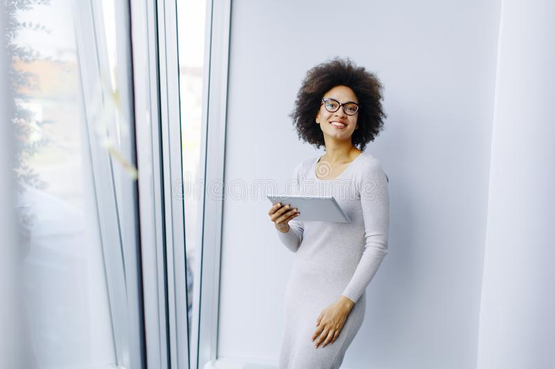 Young African American businesswoman standing wirth tablet in th stock photos