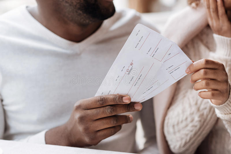 Young African American couple holding tickets royalty free stock photo
