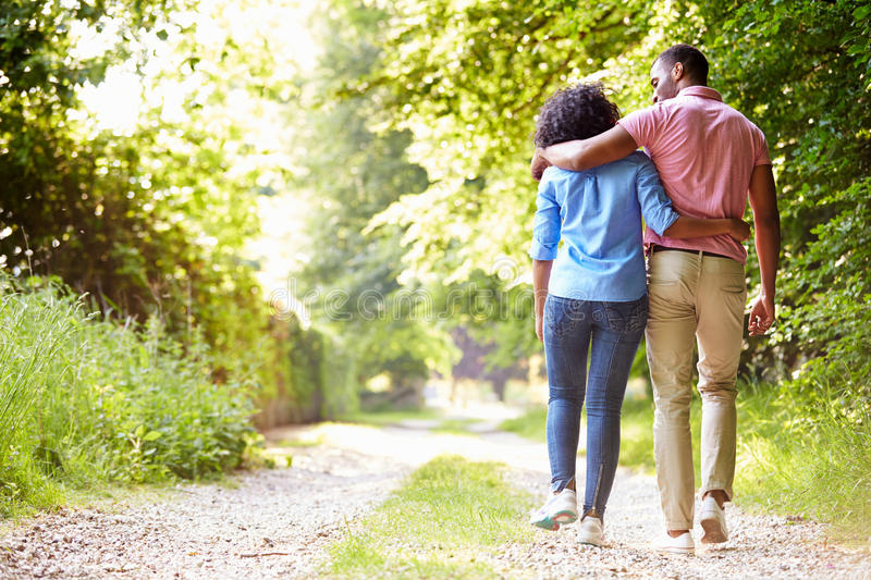 Young African American Couple Walking In Countryside royalty free stock photography