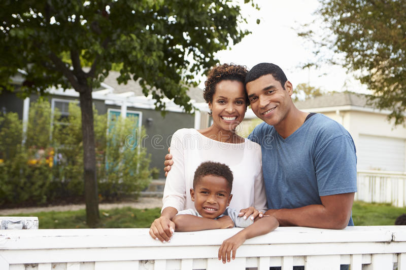 Young African American family outside their new house royalty free stock photography