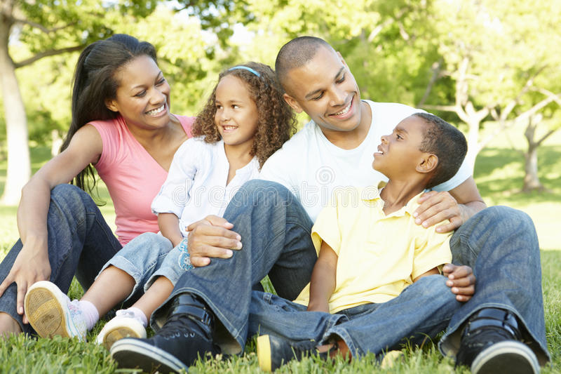 Young African American Family Relaxing In Park stock image