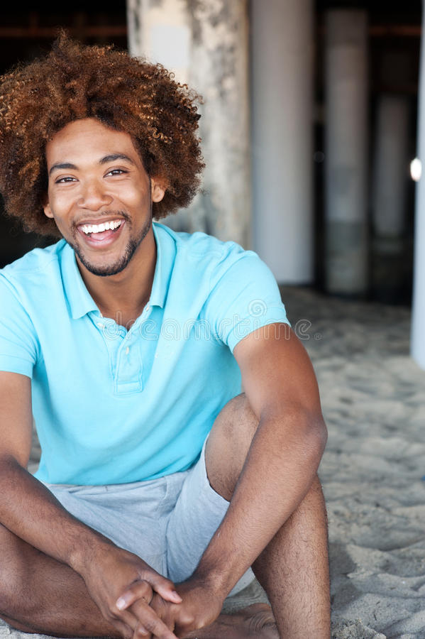Young African American man at the beach