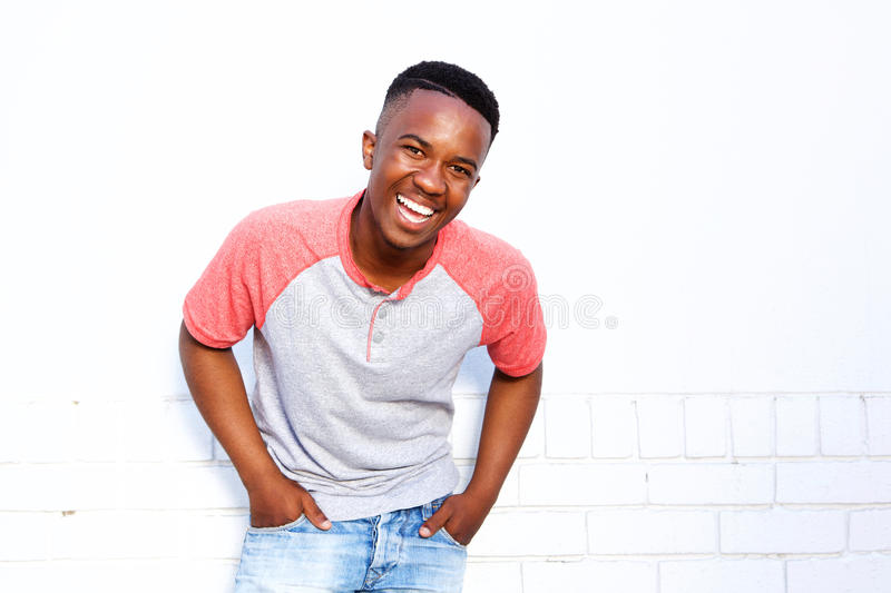 Young african american man laughing against white wall stock photos