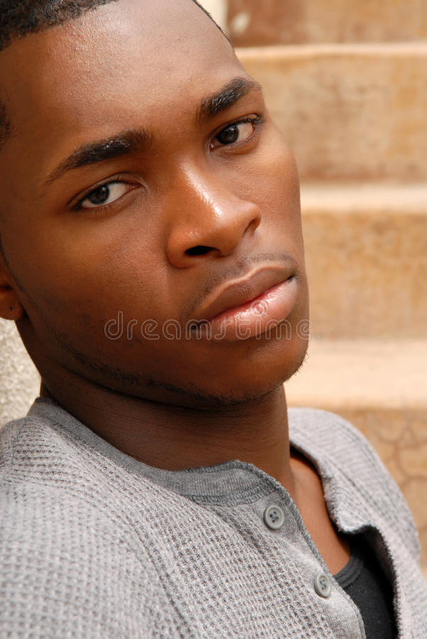 Young African American man with a sad expression stock images
