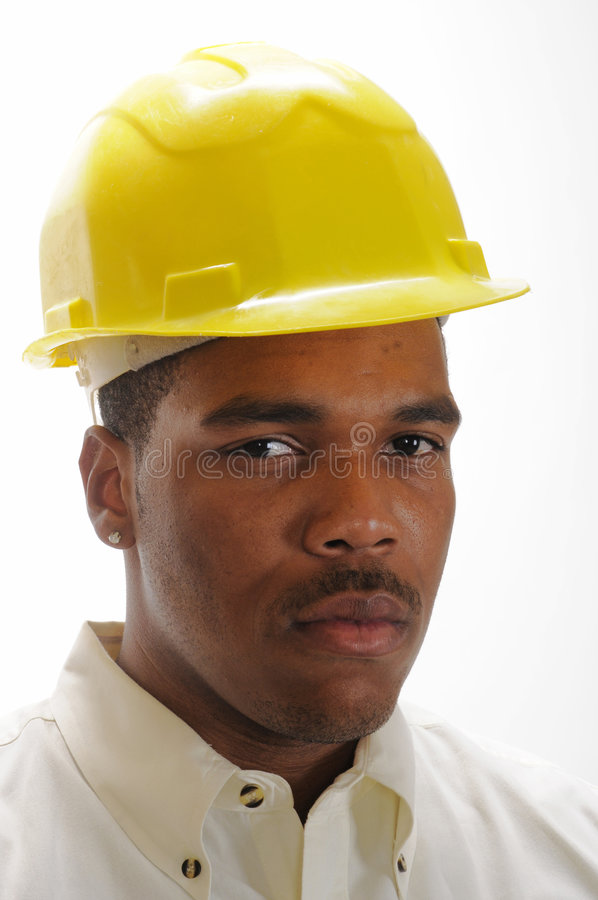 Young African American man in safety hat stock photography