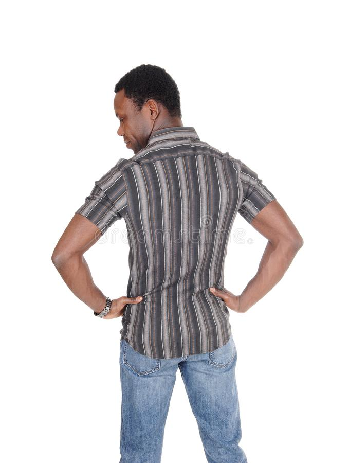 Handsome tall African man standing from back stock photo