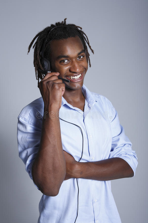 Young African American man wearing headset royalty free stock photos
