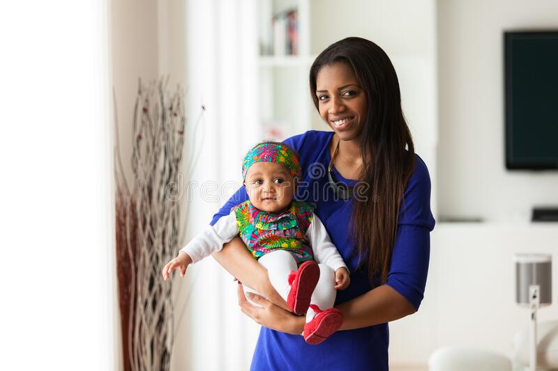 African american mother playing with her baby girl royalty free stock image