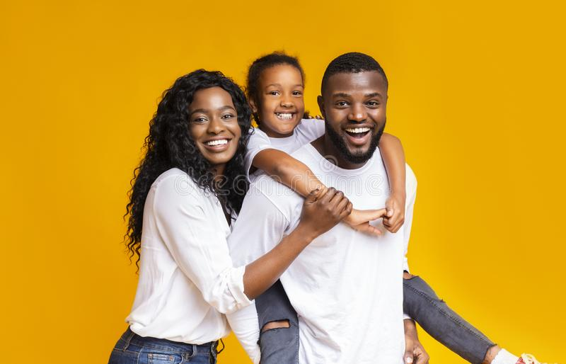 Young african american parents spending time with their little daughter stock photos