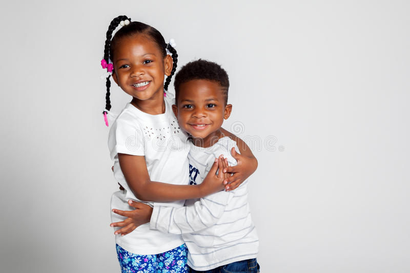 Young African American Siblings Hugging stock photography