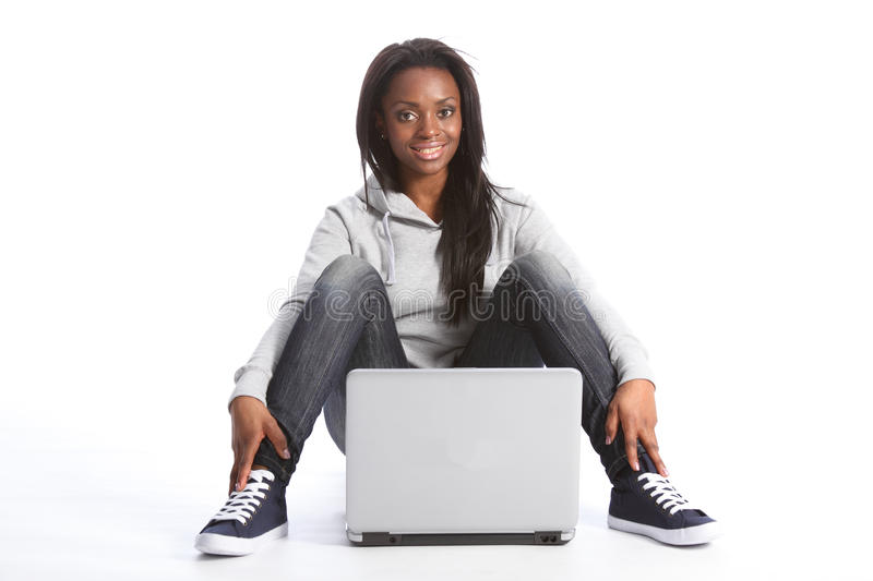Young african american student girl with computer royalty free stock photos