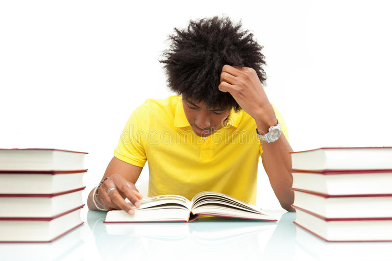Download Young African American Student Reading Books - African People Stock Photo - Image: 31065900