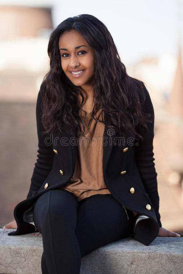Young african american teenage girl. Outdoor of a portrait happy young african american teenage girl stock photo