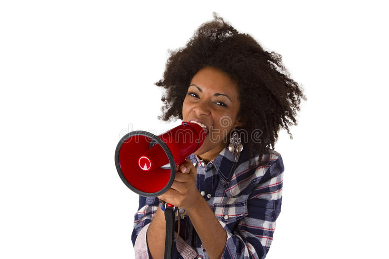 Young african american using megaphone. Young african american yelling at her megaphone isolated on white background royalty free stock photos