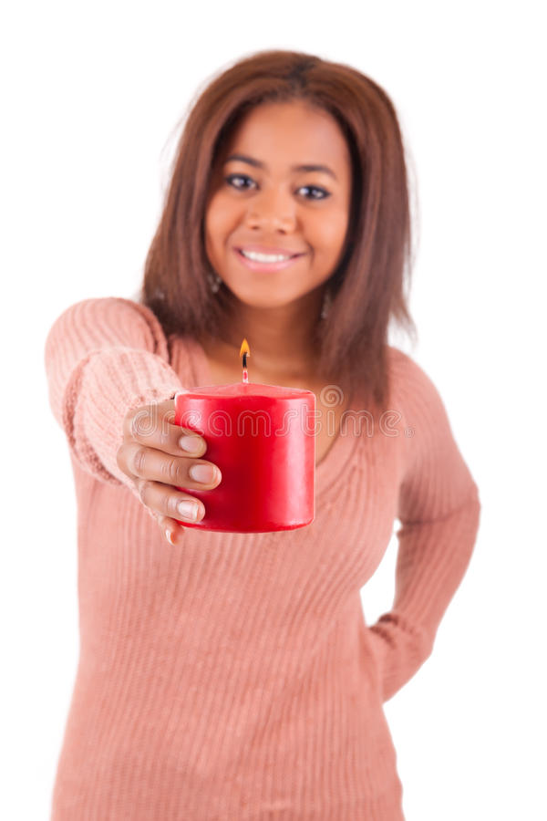 Young african american woman with candle. Isolated stock photo