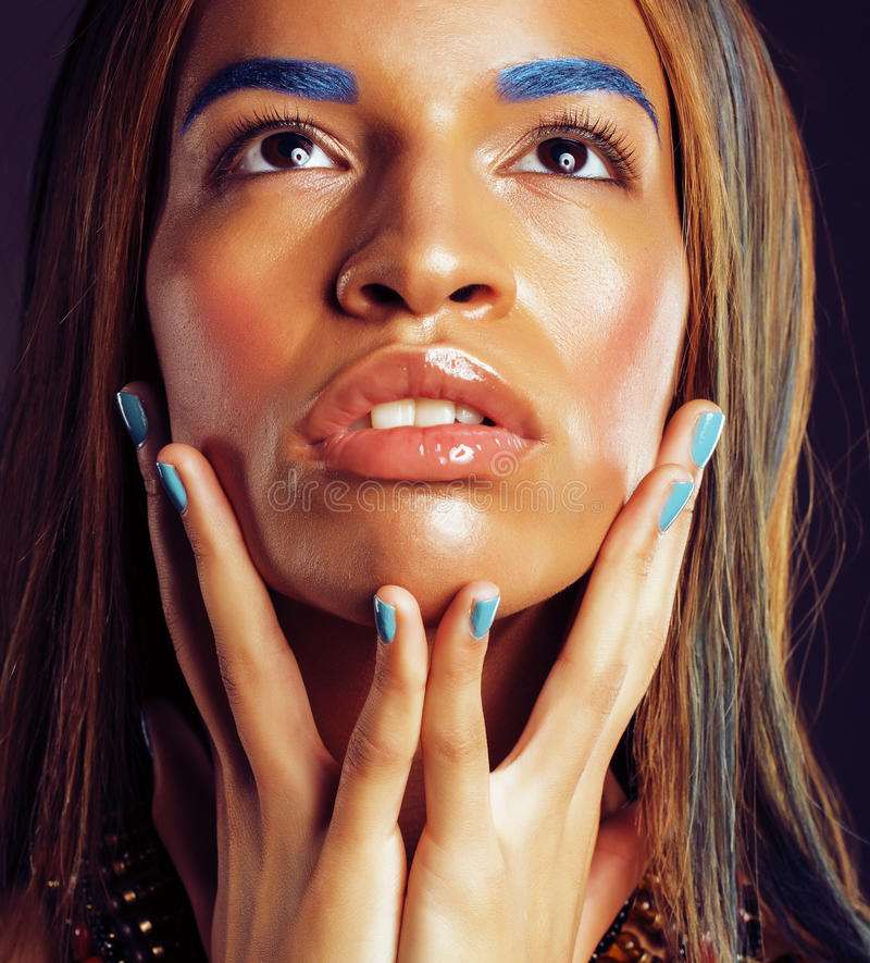 Young african american woman with creative make up like ethiopian jewelry. Closeup stock image