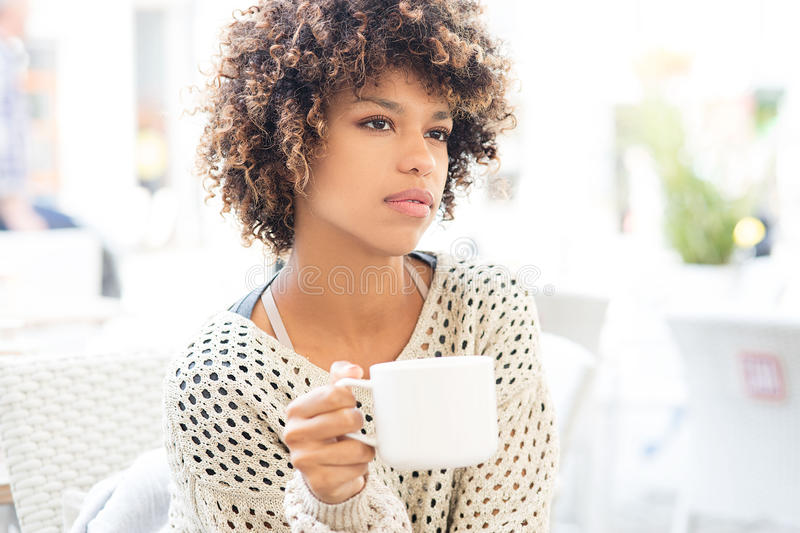 Young african american woman drinking coffee. stock image
