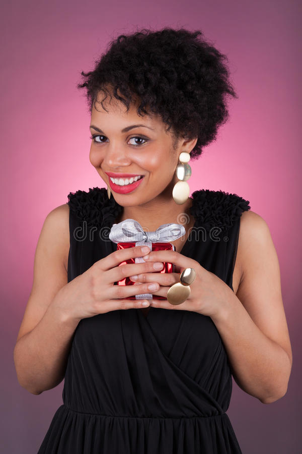 Young African American woman holding a gift stock photography