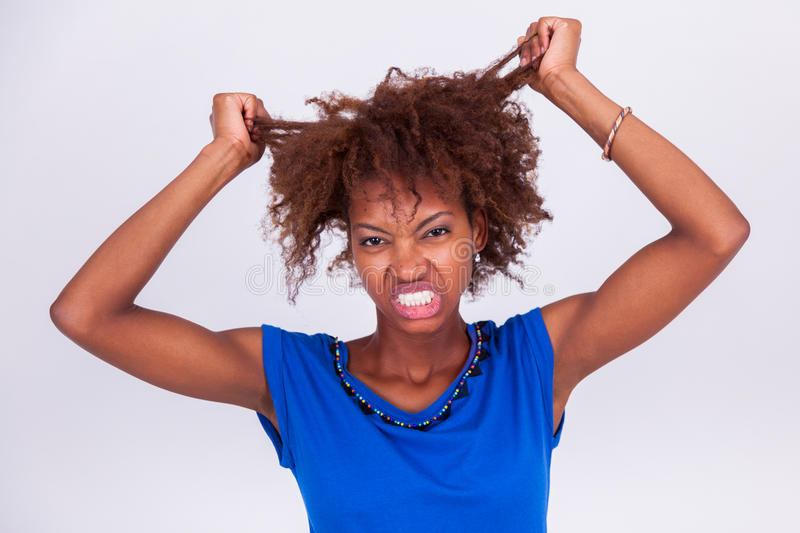Young African American woman holding her frizzy afro hair - Blac royalty free stock photos